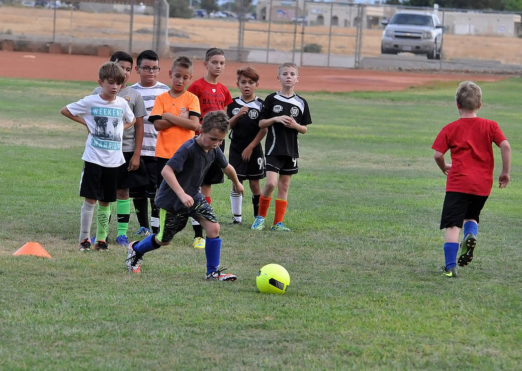 Horace Langford Jr./Pahrump Valley Times  Boys from a club team participate in a free clinic at Ian Deutch Park last Thursday. Club soccer has exploded in Pahrump. The valley now has six teams and ...