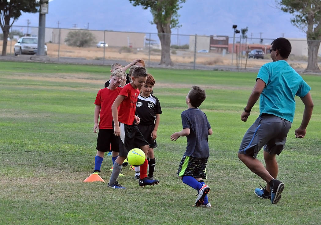 Horace Langford Jr./Pahrump Valley Times  Middle school teacher Armando Veloz gets a workout at Ian Deutch Park last Thursday with some of the kids that will be playing club soccer this year. The  ...