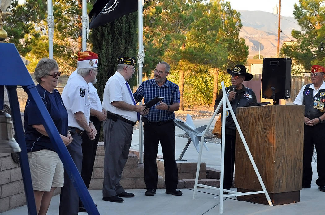 Horace Langford Jr./Pahrump Valley Times  Nye County Commissioner Dan Schinhofen presents Greg Cardarelli, Commander of Pahrump's DAV Chapter 15, with a Purple Heart Day proclamation from Governor ...