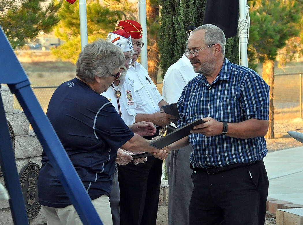 Horace Langford Jr./Pahrump Valley Times   Nye County District V Commissioner Dan Schinhofen presents Alice Lubbers with the governor's Purple Heart Day proclamation. Lubbers is the Vice Chair of  ...