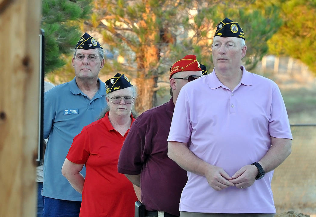 Horace Langford Jr./Pahrump Valley Times Local retired veterans observe Monday's Purple Heart Proclamation ceremony on Monday Aug 7 at the Veterans Section of Chief Tecopa Cemetery.