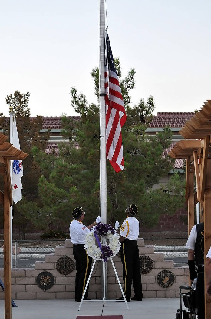 Horace Langford Jr./Pahrump Valley Times The Disabled American Veterans Honor Guard raises the American flag to full staff honoring the Purple Heart Living Warriors during a Purple Heart ceremony  ...
