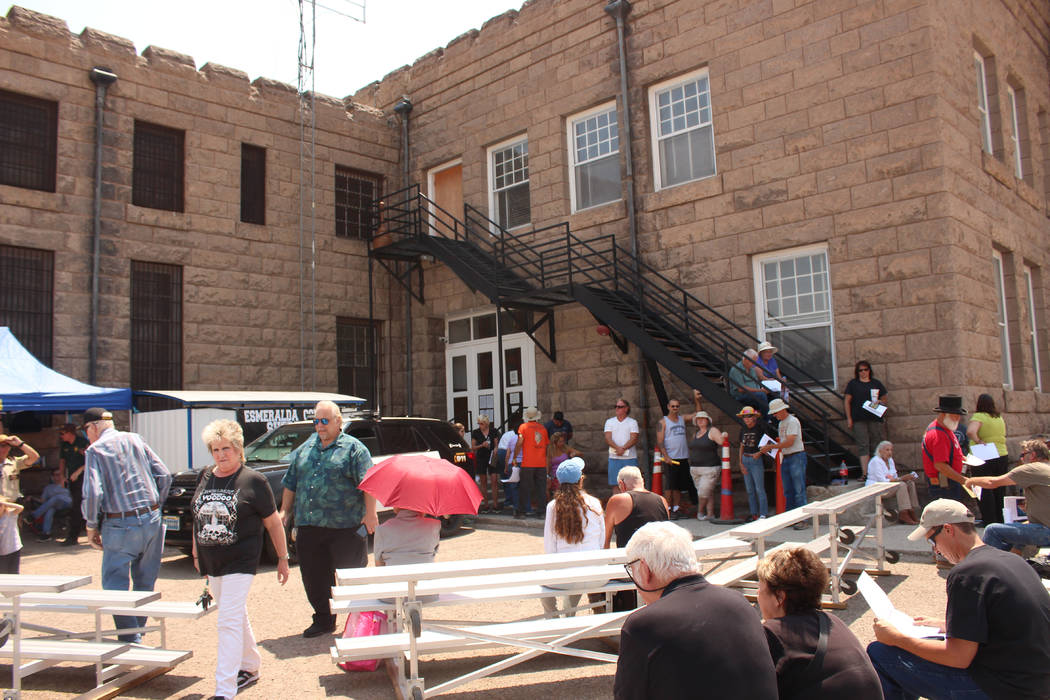 Jeffrey Meehan/Times-Bonanza & Goldfield News  Dozens of bidders for land in Goldfield and beyond start to gather near the courthouse at 233 Crook Ave. on Aug. 5. There were 17 properties and  ...