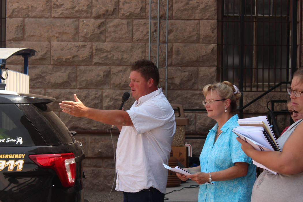 Jeffrey Meehan/Times-Bonanza & Goldfield News  Auctioneer and Esmeralda County clerk take bids on 17 properties and one mining claim at the courthouse at 233 Crook Ave. in Goldfield on Aug. 5. ...