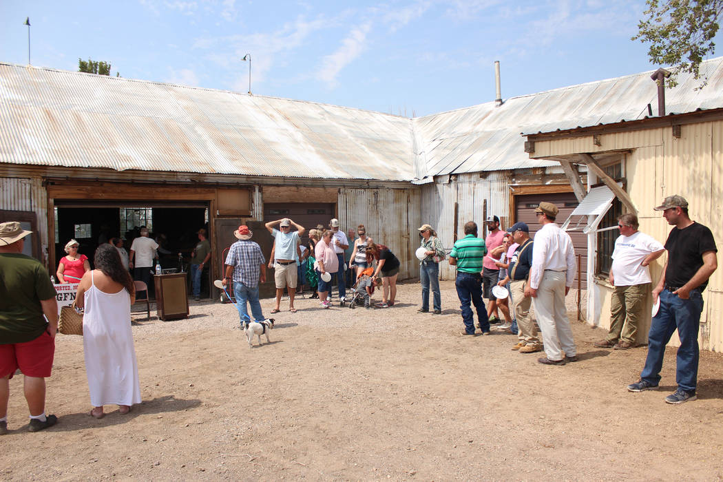 Jeffrey Meehan/Times-Bonanza & Goldfield News   People line up near the Goldfield Hotel on Aug. 5 for an auction for dozens of doors from the hotel were being auctioned off. Roughly 100 to 125 ...