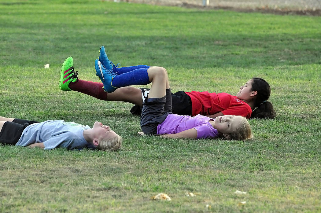 Kids at Ian Deutch Park start their workout. What started off as a team workout has become a huge gathering, sometimes well over 50 kids and an annual tradition. It is a three-week sports clinic f ...