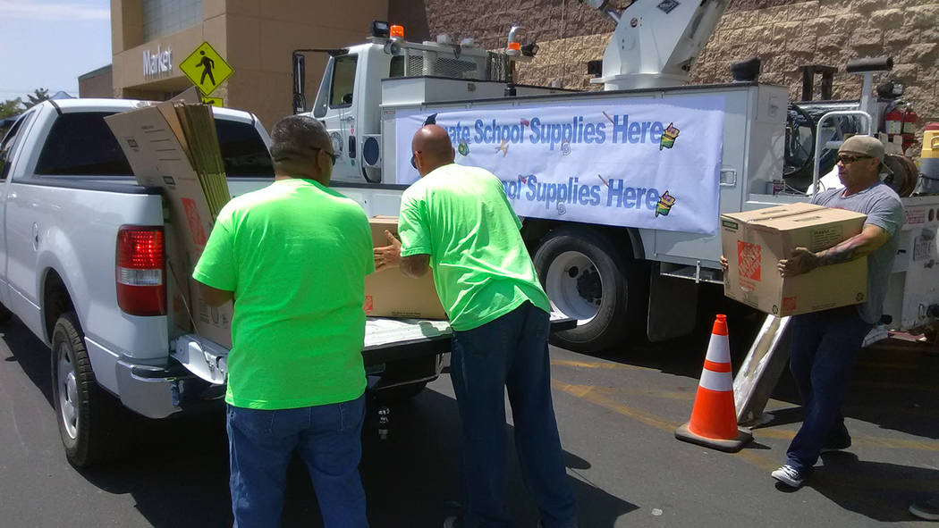 "Selwyn Harris/Pahrump Valley Times Volunteers load boxes full of school supplies during Saturday's ""Fill the Bucket"" campaign. The Valley Electric Association (VEA) sponsored annual event collecte ..."