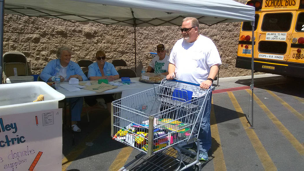 "Selwyn Harris/Pahrump Valley Times A shopper at Walmart prepares to drop off school supplies in VEA's bucket on Saturday as the annual ""Fill the Bucket"" campaign returned just in time for the star ..."