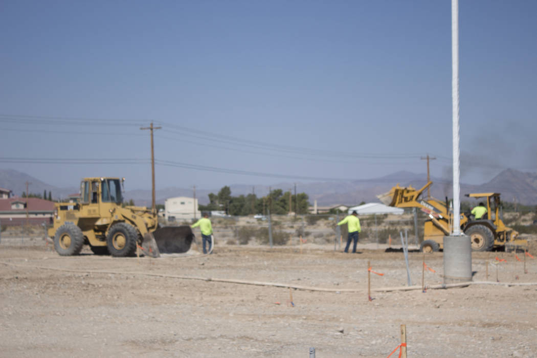 Jeffrey Meehan/Pahrump Valley Times Construction crews readying ground to pave the driveway for the new Jack in the Box restaurant on August 14, 2017. This is the first national fast-food restaura ...