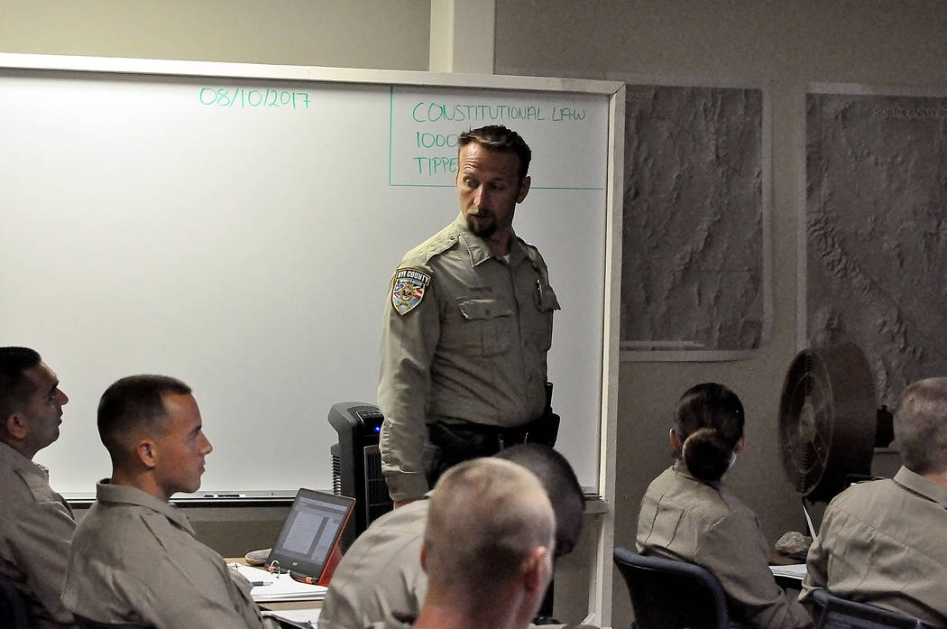 Horace Langford Jr./Pahrump Valley Times  Adam Tippetts, the training coordinator for the Nye County Sheriff's Office Regional Training Academy, teaches 12 recruits constitutional law. A large p ...