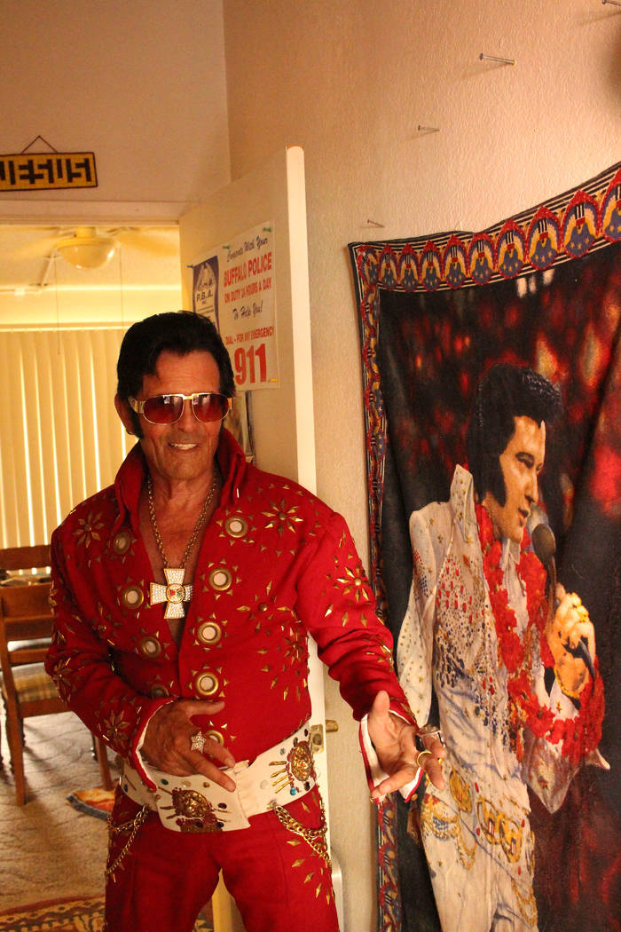 """Jeffrey Meehan/Pahrump Valley Times  Johnny V, local Elvis impersonator, stands next to the """"King"""" at his home in Comstock Park subdivision on Aug. 11, 2017. He's performed across the U.S. and int ..."""