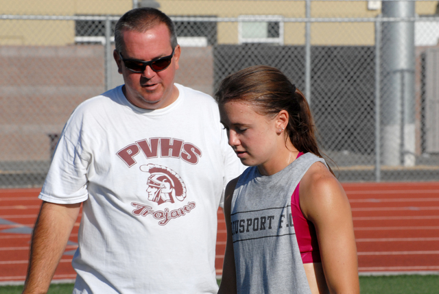 Horace Langford Jr.*/PVT -  Joe Sladek with his daughter Sydney during a Trojans soccer practice. Joe Sladek was a big supporter of club soccer in town. The 2011 and 2012 teams won two state title ...