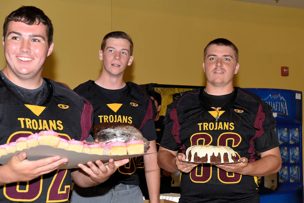 Peter Davis/Special to the Pahrump Valley Times  Trojan players led by lineman Jeremy Albertson lined up with cakes for the next-up bidding. The fundraiser raised $10,750 for the football team.