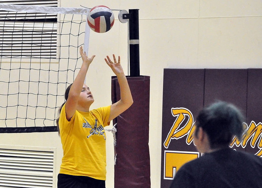 "Kate Daffer, a freshman volleyball player, practices in the gym on Monday. Daffer is regarded by Jill Harris as a player with ""a lot of potential early."""