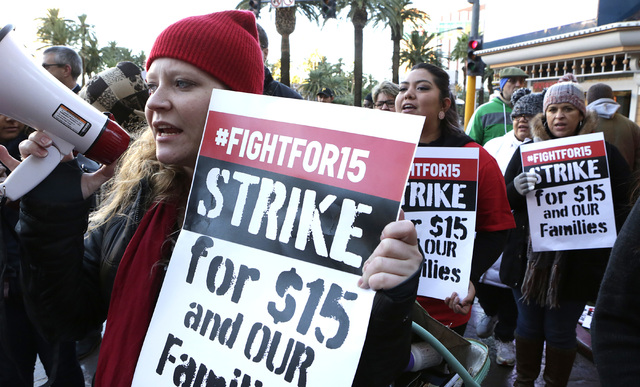 Bizuayehu Tesfaye/Las Vegas Review-Journal  Emily Ross shouts slogans as she joined workers fighting for a higher minimum wage protest outside of a McDonald's on Las Vegas Boulevard, Tuesday, Nov. ...