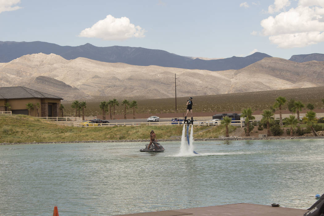 Jeffrey Meehan/Pahrump Valley Times McKenna Jaques, winner of Travel Nevada's essay contest for 2017, flies high above the lake on her jet board at Jetpack America at the Spring Mountain Motorspor ...