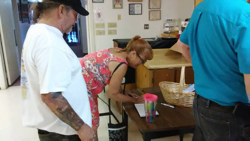 Selwyn Harris/Pahrump Valley Times Friends and associates line up to sign a guest book for Alice Eychaner at the Pahrump Moose Lodge on Saturday Aug. 12.