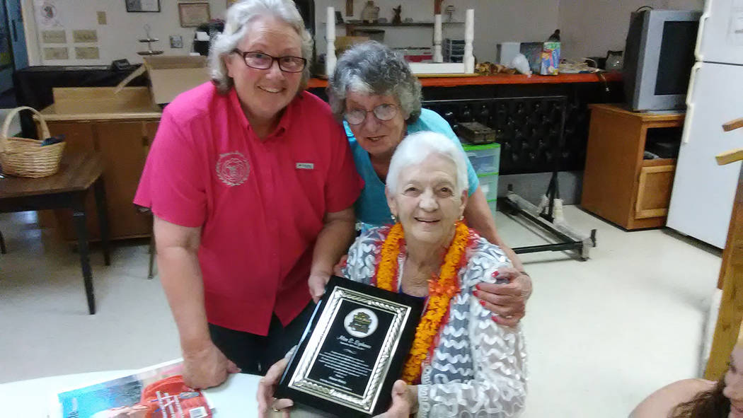 Selwyn Harris/Pahrump Valley Times Longtime Pahrump resident Alice Eychaner holds a plaque of appreciation presented during her farewell party on Saturday Aug. 12 at the Pahrump Moose Lodge. Eycha ...