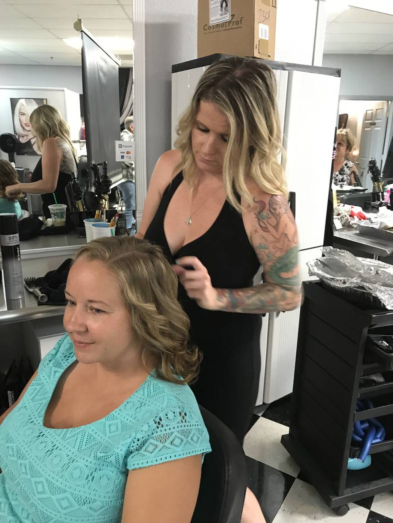 Local resident Sunday Wood in process of getting her makeover at Shear Image Salon at 2301 Winery Road. Wood was one of two winners of the Makeover Madness contest, given in concert with the salon ...