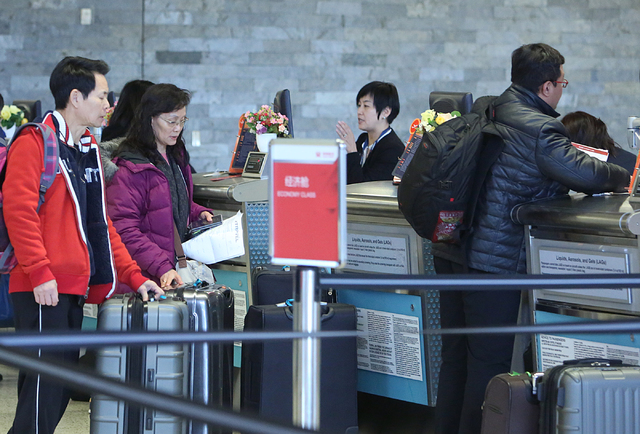 Passengers check-in for their flight at the Hainan Airlines ticket counter on Monday, Feb. 27, 2017 at McCarran International Airport in Las Vegas. (Bizuayehu Tesfaye/Las Vegas Review-Journal) @bi ...