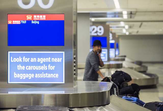 A passenger from a Hainan Airlines flight from Beijing exits baggage claim at McCarran International Airport on Wednesday, Jan. 11, 2017. (Jeff Scheid/Las Vegas Review-Journal) @jeffscheid