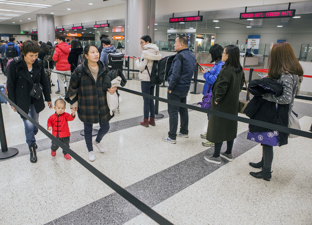 Passengers from a Hainan Airlines flight from Beijing wait to clear customs at McCarran International Airport on Wednesday, Jan. 11, 2017. (Jeff Scheid/Las Vegas Review-Journal) @jeffscheid