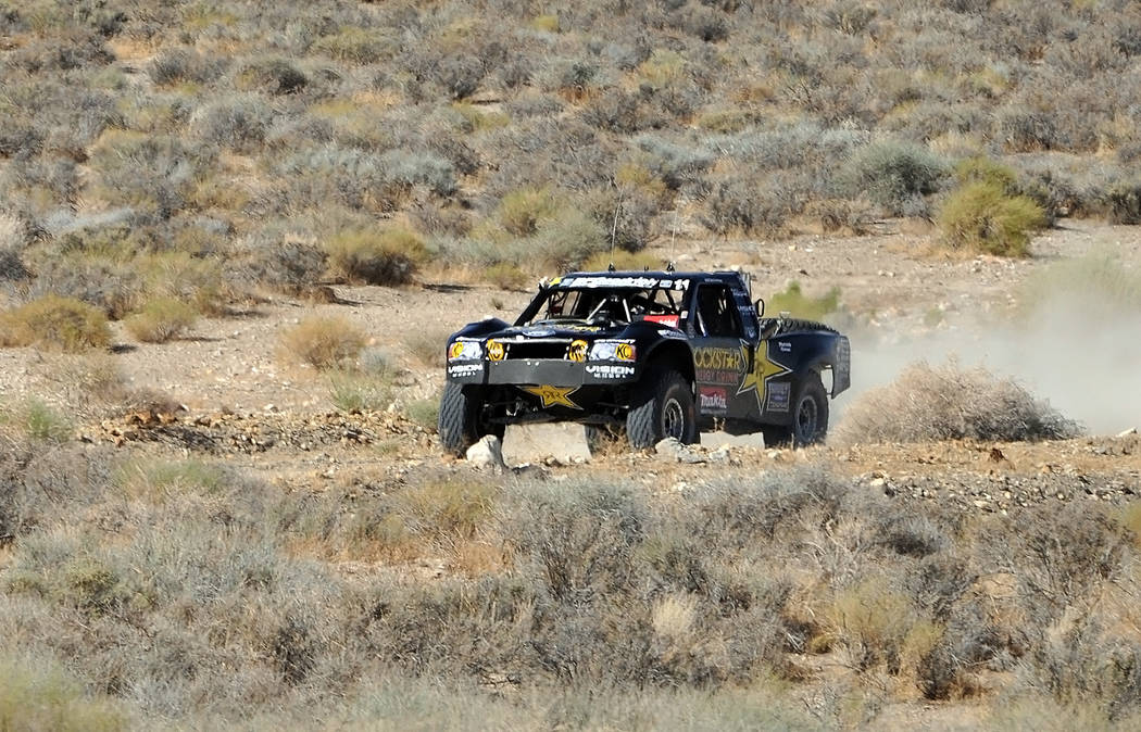 Rob MacCachren's Rock Star Energy truck, No. 11, a couple of miles into the race at high speed outside of Beatty.
