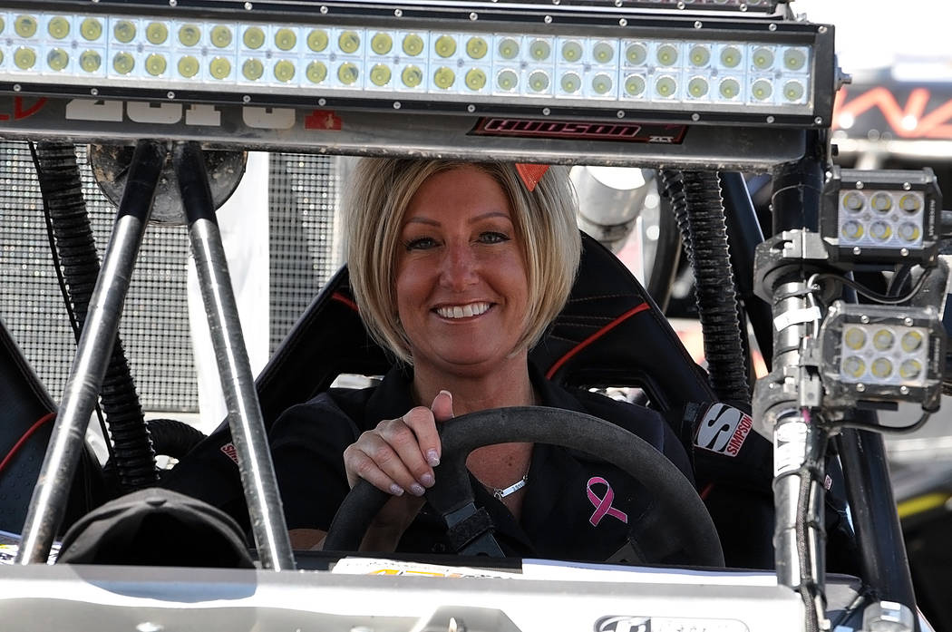 Horace Langford Jr./Pahrump Valley Times  UTV Unlimited driver Renee Hudson, behind the wheel at the Texas Station tech inspection on Thursday. She races for the Getting Dirty for the Ta Tas Racin ...