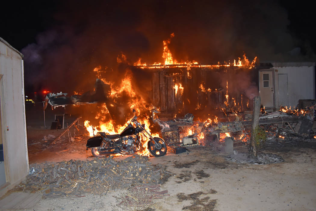 Special to the Pahrump Valley Times On Saturday Aug. 19, fire crews were dispatched for a structure fire along Linda Street just after midnight. The fire caused extensive damage to a double-wide m ...