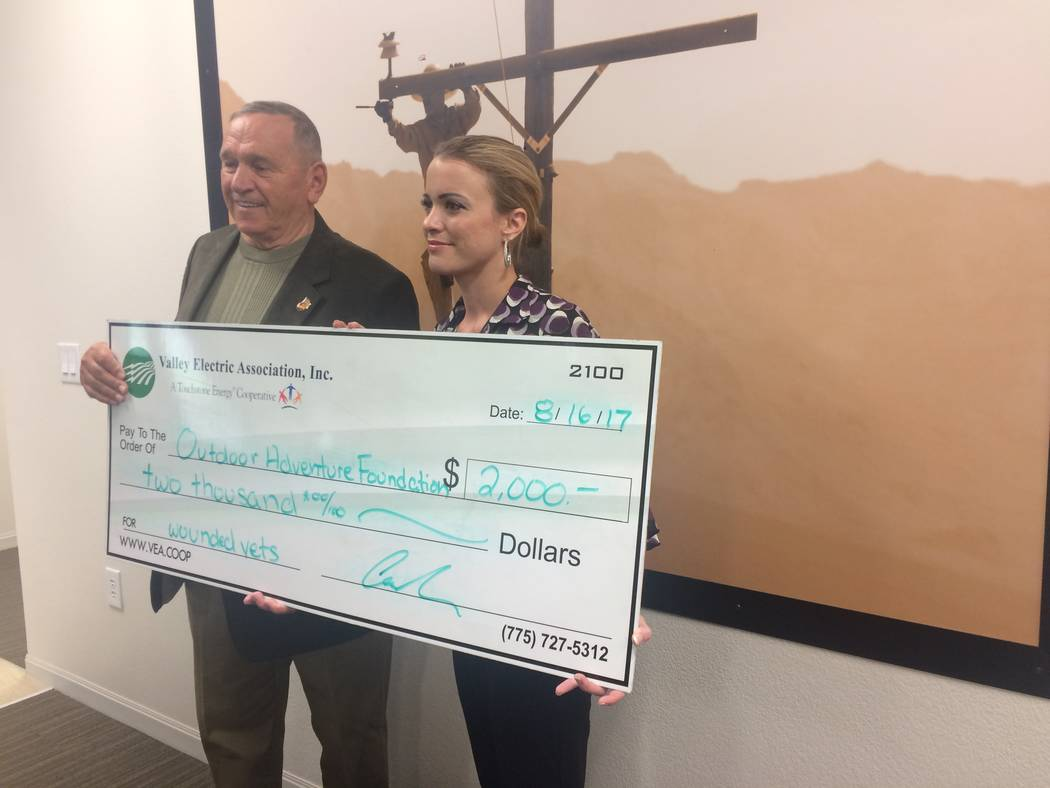 Special to the Pahrump Valley Times- Cassandra Selbach, chief evangelist at Valley Electric Association presented a $2,000 check to General Emil R. Bedard last week. Sellback said that the coopera ...