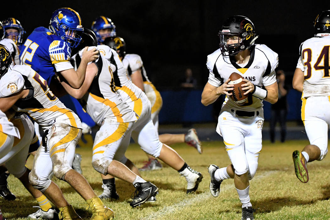 Peter Davis/Special to the Pahrump Valley Times  Dylan Coffman drops back to pass in last year's playoff game against the Moapa Valley Pirates. Coffman will lead the Trojans offense this year. T ...