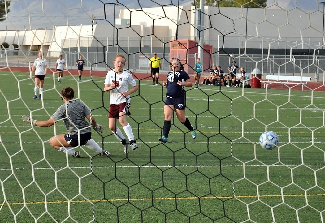 Freshman Makayla Gent scores a goal against Somerset-Sky Pointe in the second half. She also had two assists in the first half of the game.