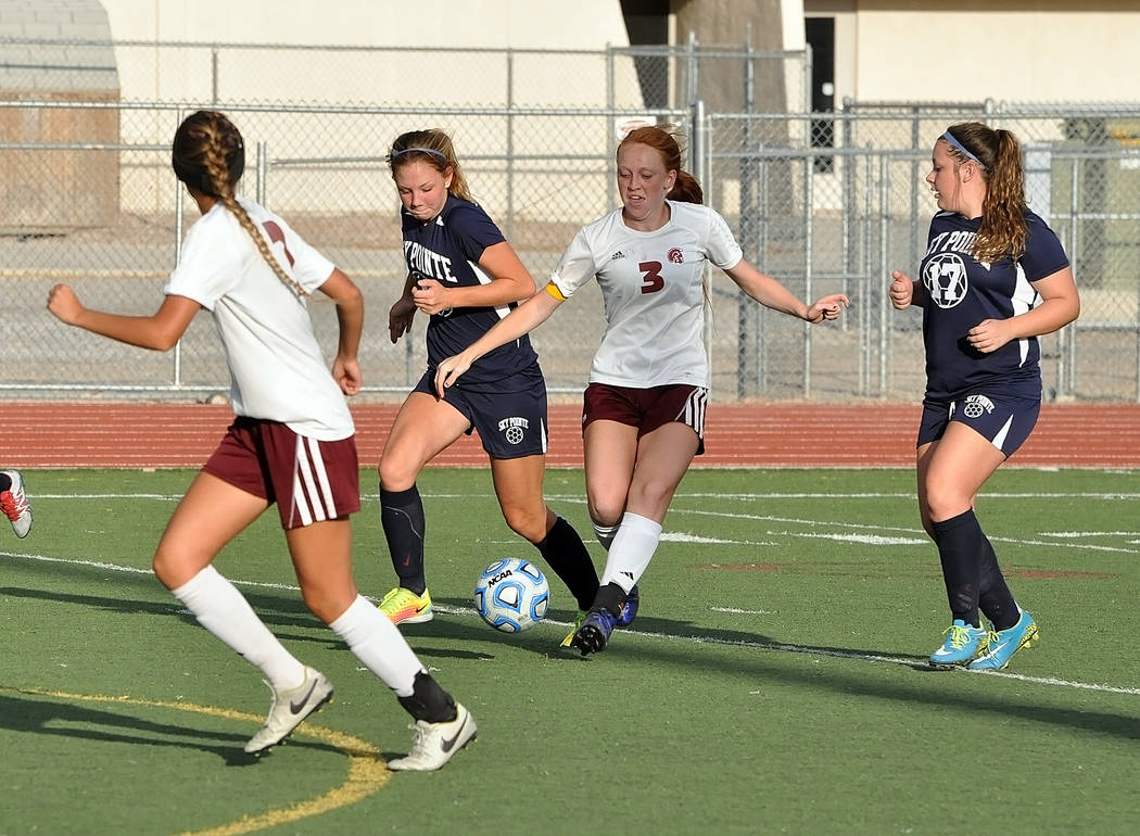 Horace Langford Jr./Pahrump Valley Times Senior Kaitlyn Carrington passes the ball during the Monday girls soccer opener vs. Somerset-Sky Pointe Academy. Carrington scored two goals in the first h ...