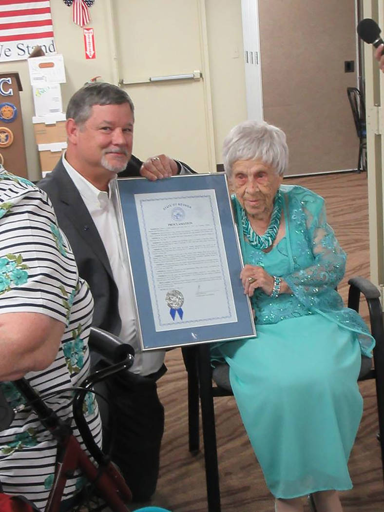 Special to the Pahrump Valley Times  Nevada District 36 Assemblyman James Oscarson James Oscarson presents a proclamation to Geneva Dulaney during a 100th birthday celebration on July 24. Dulany w ...