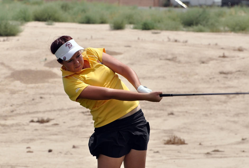 Horace Langford Jr./Pahrump Valley Times  Makalea Petrie made this bunker shot look easy on hole two. She shot her best round of golf, a 15-over-par 87 against Bishop Gorman at Mountain Falls last ...