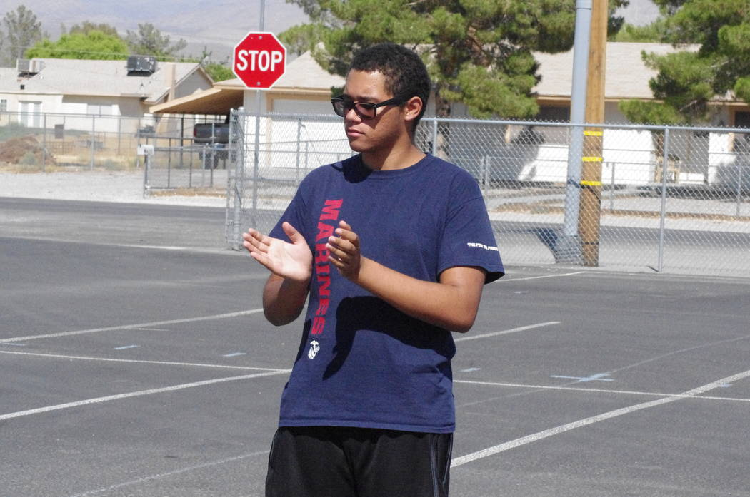 Vern Hee/Pahrump Valley Times The Pahrump Valley High School Trojans marching band practicing during the first week of school. Brian Louder Jr. is seen keeping the time for the band. This year the ...