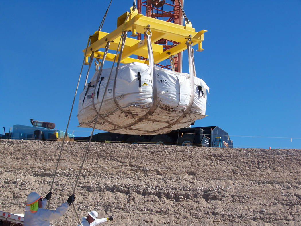 Special to the Pahrump Valley Times Workers offload supersack shipments with enhanced contamination at the Nevada National Security Site. The Nevada Division of Environmental Protection issued a m ...