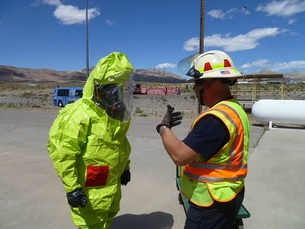 Special to the Pahrump Valley Times Nye Technical Response Division Chief Rich Flanagan confers with firefighter James Rice during a training excercise. Flanagan is seeking candidates interested i ...