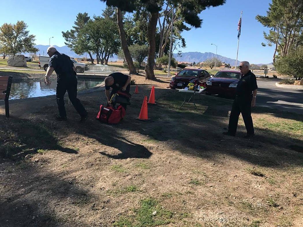 Special to the Pahrump Valley Times  Members of Nye County Technical Response prepare for a water rescue training drill at the Calvada Eye. Volunteer firefighter classes begin in January, as the n ...