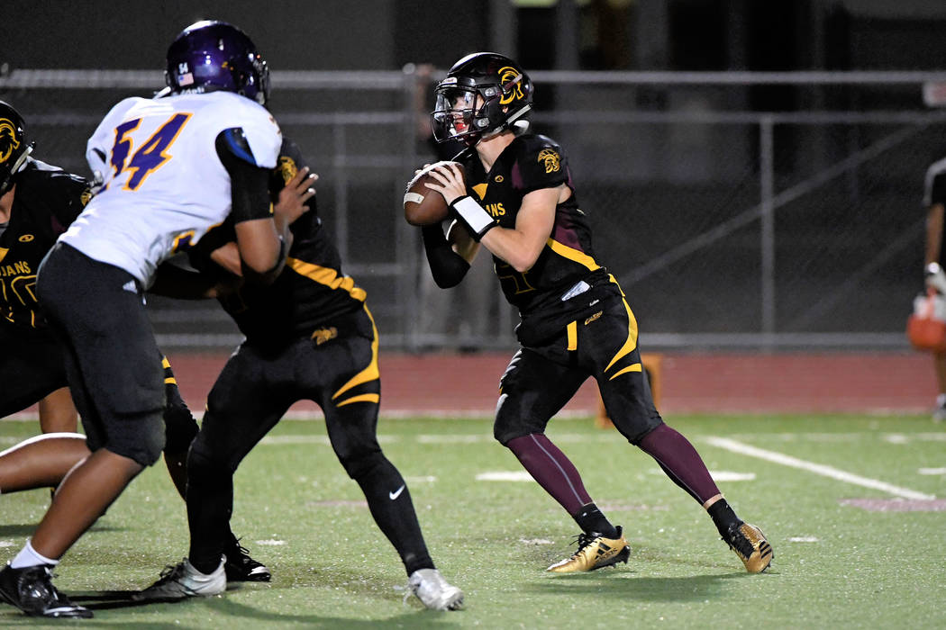 Peter Davis/Special to the Pahrump Valley Times Dylan Coffman sees Cory Bergman wide open just before he throws him a 12-yard pass in the end zone. This TD made the score 19-13 in the third quarter.