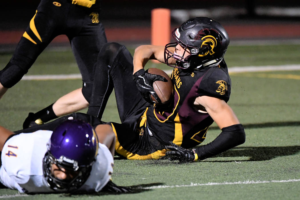 Peter Davis /Special to the Pahrump Valley Times Senior Cory Bergan comes down with a big touchdown after catching a Dylan Coffman pass for six on Friday against Durango.