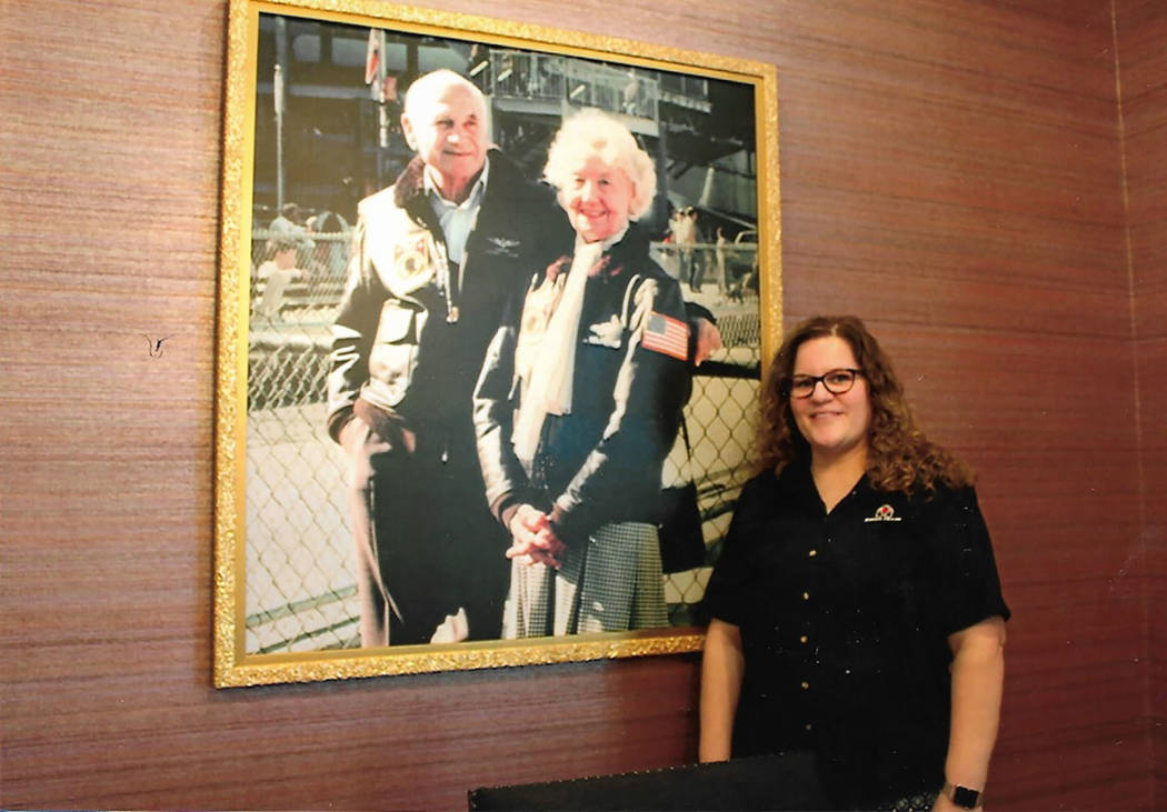 Chuck Baker/Special to the Pahrump Valley Times Cadie Franco, manager of the Southern Nevada Fisher House, poses in front of a portrait of founders Zachary and Elizabeth Fisher.