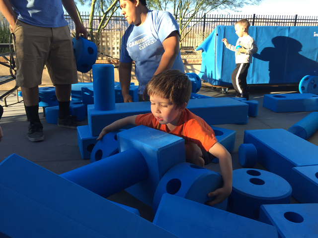 Keith Rogers/Las Vegas Review-Journal Zachary York, 4, plays with some of the blue foam toys Thursday, Oct. 20, 2016, that are part of the new Imagination Playground at the Veterans Affairs Southe ...