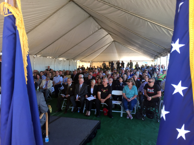 Keith Rogers/Las Vegas Review-Journal Veterans and VA officials listen to a speaker during a groundbreaking ceremony Friday, March 27, 2015, for Fisher House for wounded warriors near the North La ...