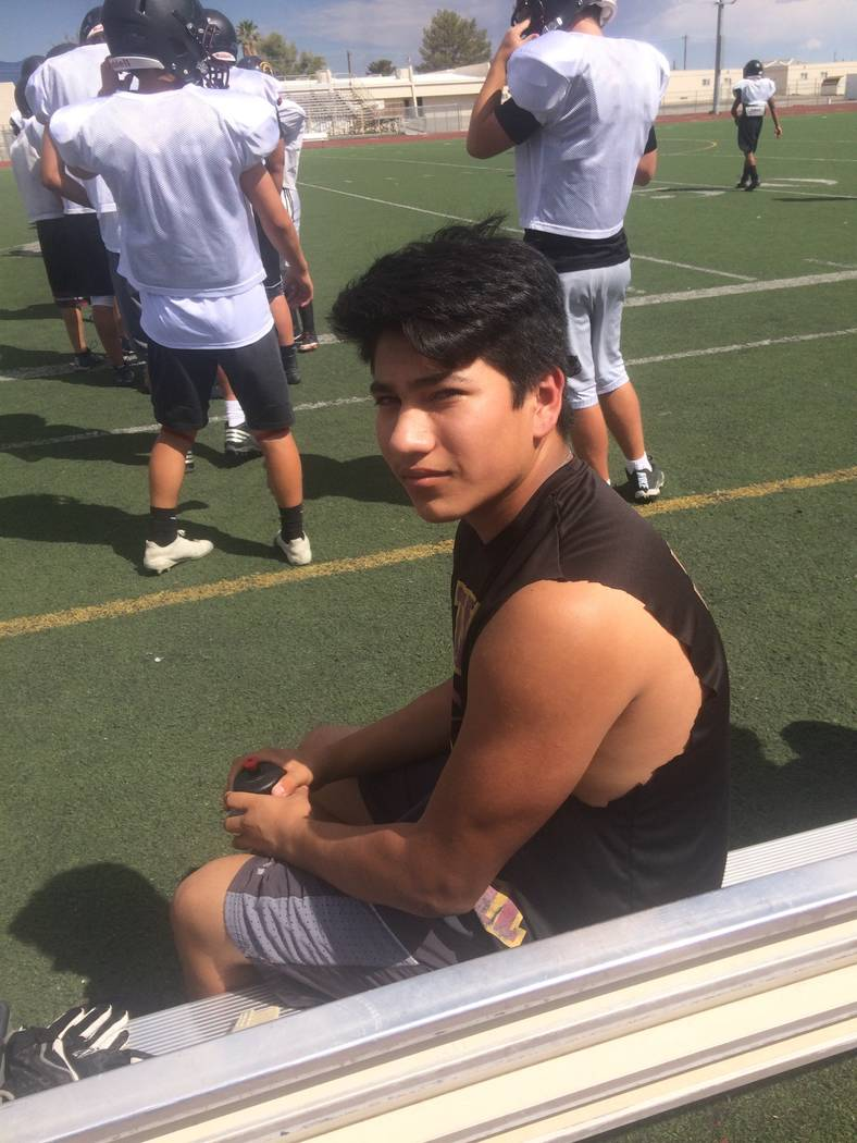 Vern Hee/ Pahrump Valley Times Sophomore linebacker Anthony Peralta heals up from a game-related injury while watching his teammates practice on Monday. He said he should be back on the field for  ...