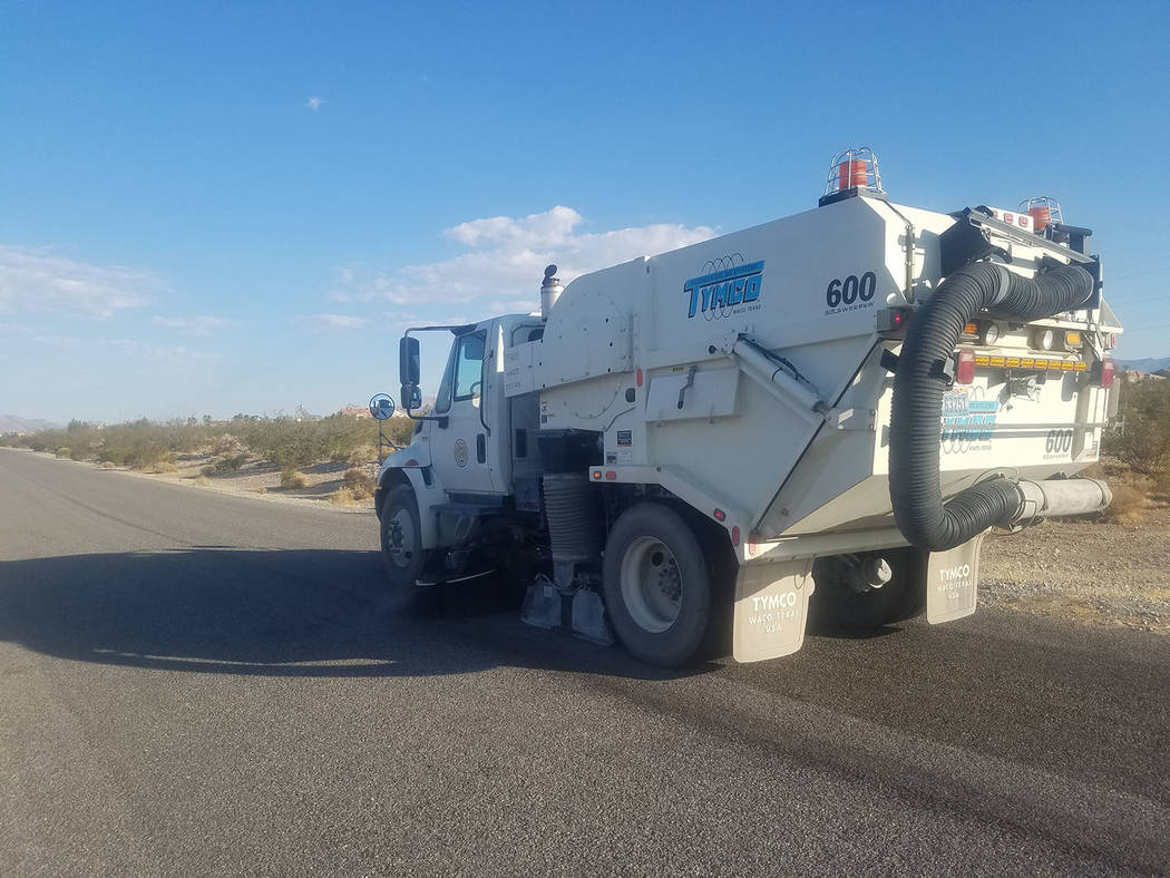 David Jacobs/Pahrump Valley Times A street sweeping truck works along Cortina Street, east of Highway 160 in Pahrump, earlier this month.