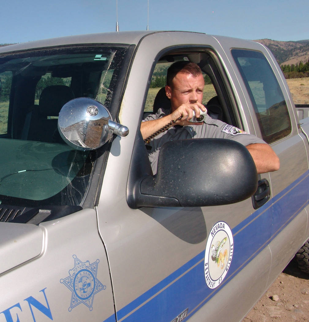 Special to the Pahrump Valley Times  Game Warden Cameron Waithman checks in on the radio while on wildlife patrol. Officials with the Department of Wildlife said game wardens discovered several ki ...
