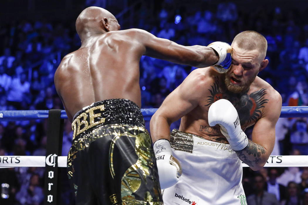 Esther Lin/SHOWTIME file Floyd Mayweather landing a punch on McGregor during the Aug. 26 fight. Mayweather wore McGregor down and was able to win it in the 10th round..