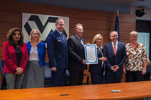 Emerson Marcus/Nevada National Guard  Nevada Gov. Brian Sandoval's chief of staff, Mike Willden, holds a proclamation for working to raise suicide awareness among veterans. Nevada National Guard A ...