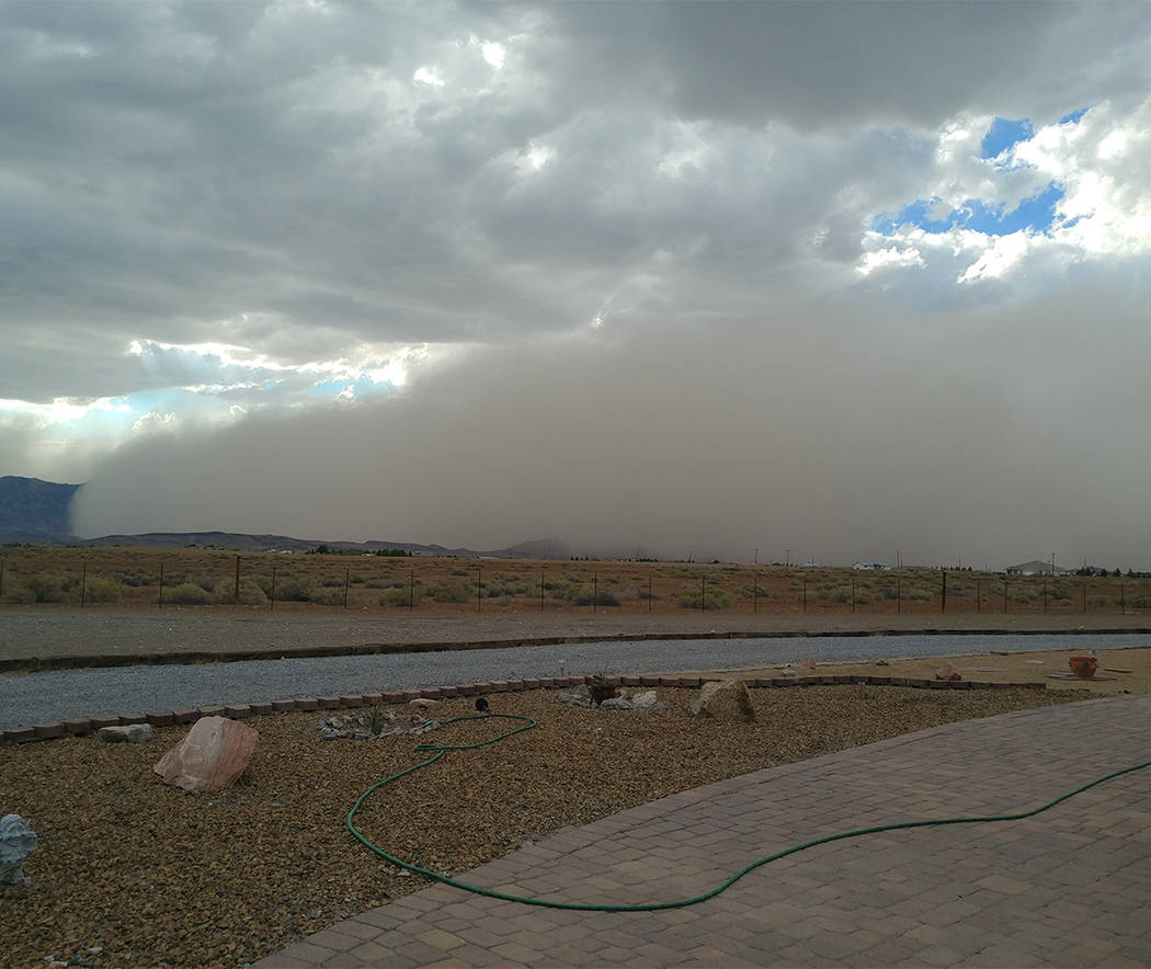 Gail Clampit/Special to the Pahrump Valley Times A photo submitted by Pahrump resident, Gail Clampit, shows the dust storm approaching from the north headed south. The mountains in the photo are t ...